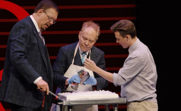 A scene from a Penn and Teller magic show