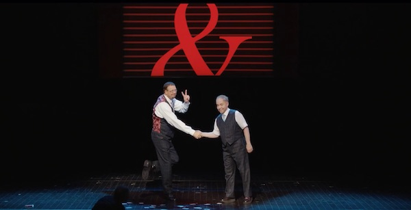 Penn and Teller performing a magic show
