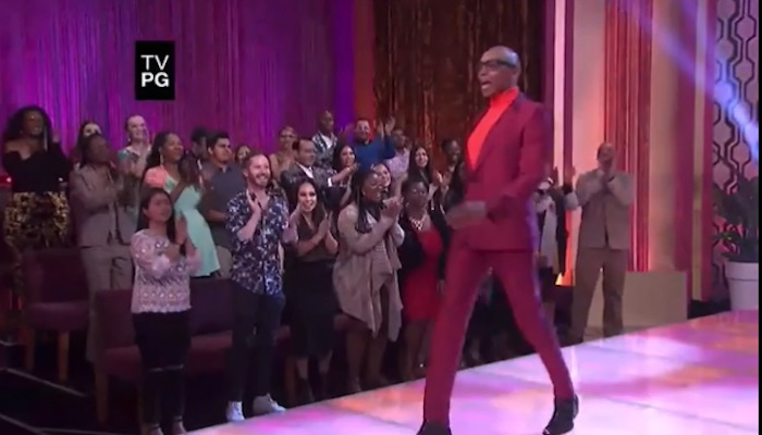 RuPaul walking down a catwalk