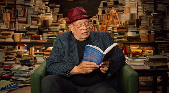 Walter Mosley reading a book