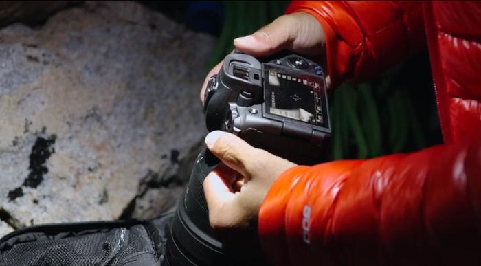 Jimmy Chin adjusting camera settings