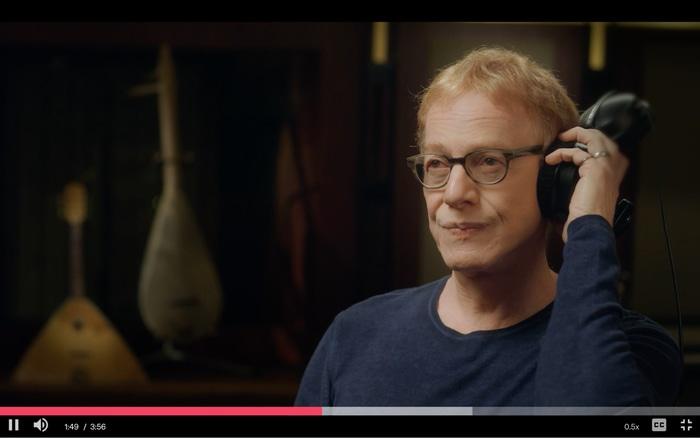 Elfman listening to music